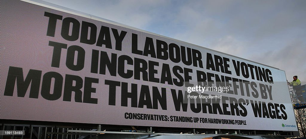 A Conservative sponsored billboard criticises The Labour party's voting intentions ahead of a vote on benefit cuts on January 8, 2013 in London, England.