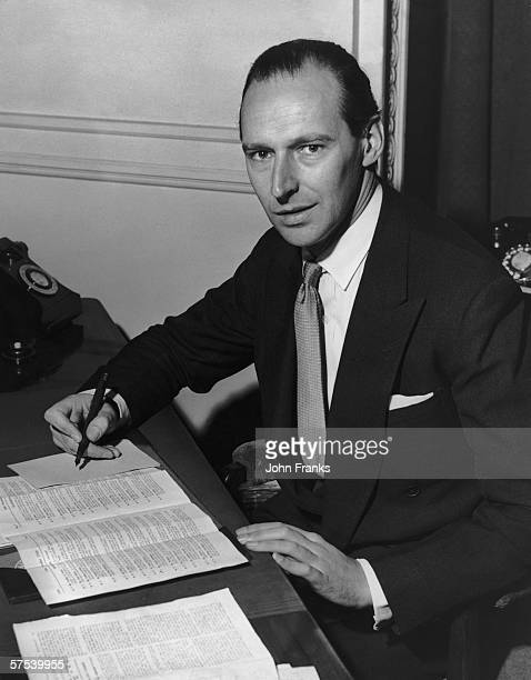 Conservative statesman William David OrmsbyGore 5th Baron Harlech at his desk in the Foreign Office following his recent appointment as Joint...