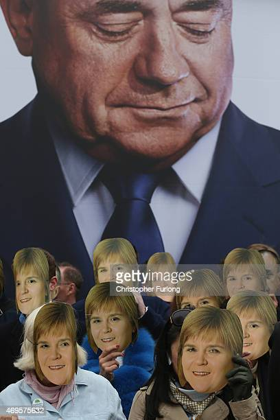 Conservative supporters wear Nicola Sturgeon and Alex Salmond masks outside the Old Granada TV studios where the Labour party are launched their...