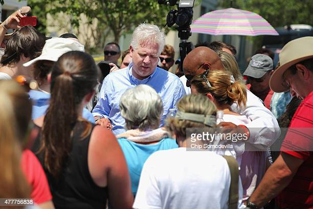Conservative television and radio personality Glenn Beck leads a crowd in prayer outside the historic Emanuel African Methodist Episcopal Church...
