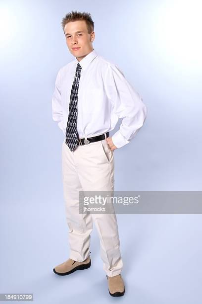 conservative young man with clipping path - beige pants stock pictures, royalty-free photos & images