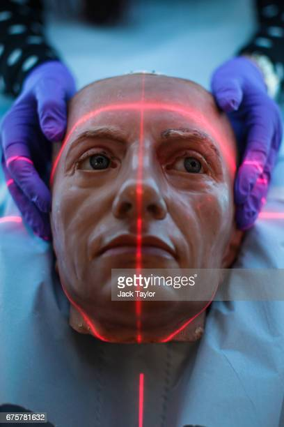 Conservator and restorer Valerie Kaufmann poses with a waxwork head of Admiral Horatio Nelson in a CT scanner before it is examined in the radiology...