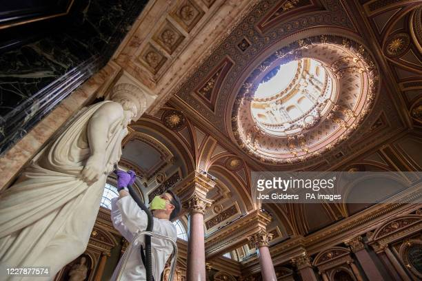 Conservator Edward Cheese cleans marble sculptures at the Fitzwilliam Museum in Cambridge as they make final preparations to reopen to the general...