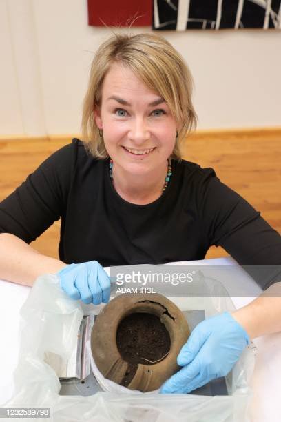 Conservator Madelene Skogbert shows a bone ring from a find from the Bronze Age on April 29, 2021 in Gothenburg, Sweden. - The find discovered in...