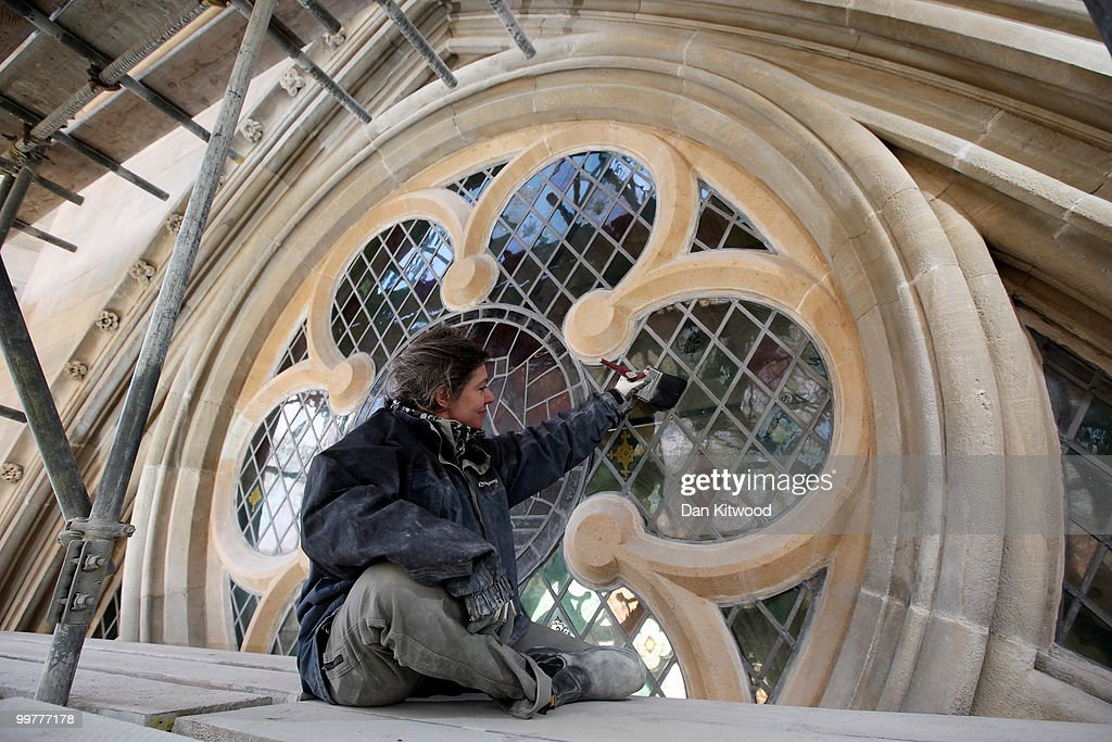 Conservator Sharon Bailey puts finishing touches to a stained glass window on Westminster Abbey's Chapter House on April 14, 2010 in London, England. Built in the 1250's Chapter House is one of London's oldest buildings, but over the years has suffered deterioration to much of its stone facade because of prevailing weather conditions. With the help of a team of stonemasons, led by English Heritage, the exterior has now been carefully returned to it's former glory with a full complement of newly carved friezes, gargoyles and fully restored stained glass windows.