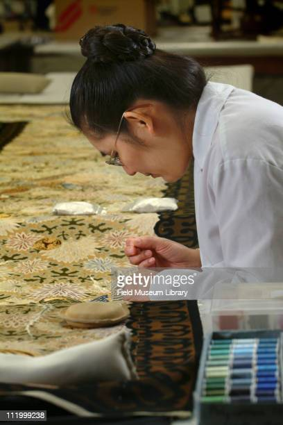 Conservator working on 22 foot Japanese Silk tapestry originally displayed at the World's Columbian Exposition of 1893 2004
