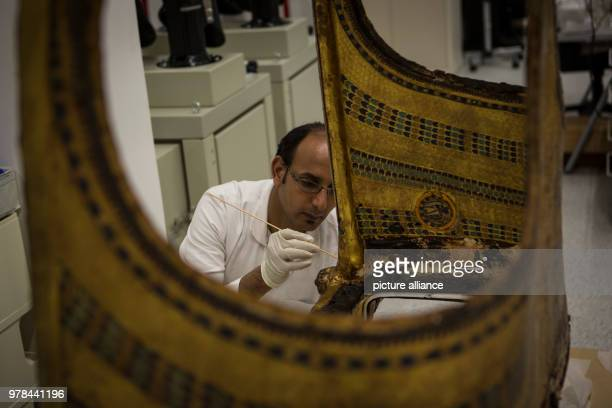 A conservator works on the restoration of an ancient Egyptian artifact at the Grand Egyptian Museum in Giza Egypt 26 April 2018 Photo Gehad Hamdy/dpa