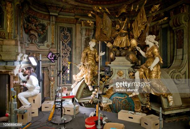 Conservatorrestorers Patricia Dornstädter and Jan Bruenner pictured during restoration work on the Margravial Opera House in Bayreuth Germany 24 May...