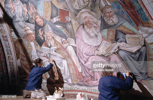 Conservators work on the restoration of a fresco in the cathedral in Orvieto Umbria Italy