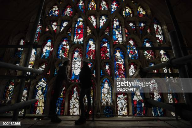 Conservators Zoe Harrigan and Anna Milsom admire a section of York Minster's 600 year-old Great East Window, following a 10-year conservation and...