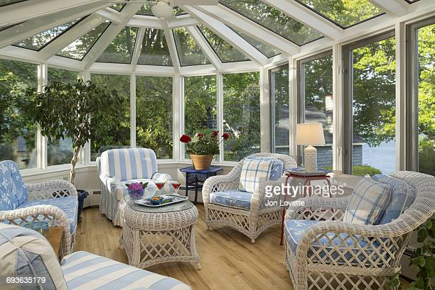 Conservatory interior in home with wicker accents