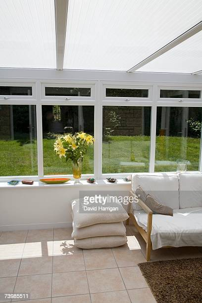 Conservatory with a view of the backyard
