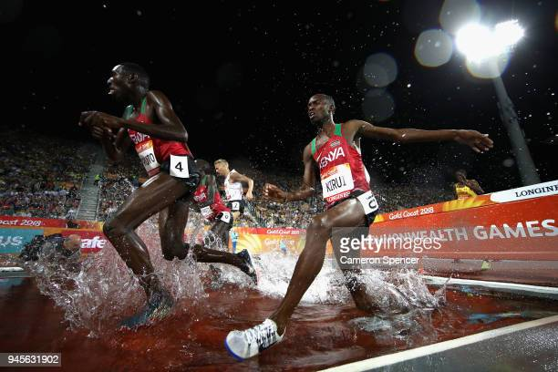 Conseslus Kipruto of Kenya and Amos Kirui of Kenya clear the water jump in the Men's 3000 metres Steeplechase final during athletics on day nine of...