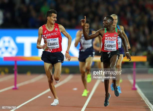 Conseslus Kipruto of Kenya gold and Soufiane Elbakkali of Morocco silver race to the finish line in the Men's 3000 metres Steeplechase final during...