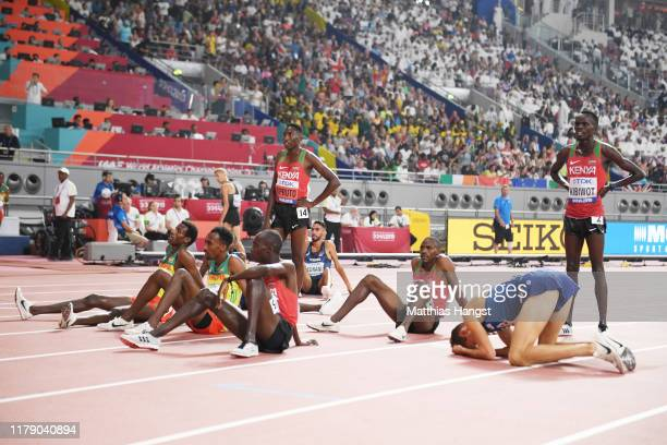 Conseslus Kipruto of Kenya Lamecha Girma of Ethiopia and others react after the Men's 3000 metres Steeplechase final during day eight of 17th IAAF...