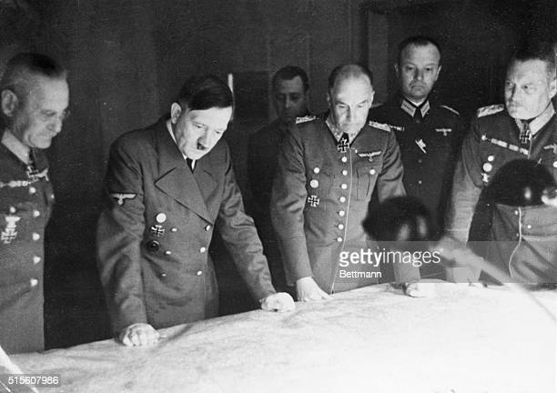 Considering Russian Campaign Adolf Hitler with General Wilhelm Keitel and General Walther von Brauchitsch view a map outlining the current...