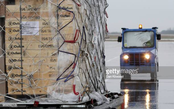 A consignment of aid from Oxfam's logistics warehouse in Oxfordshire including waits is loaded onto a British Airways flight bound for Haiti at...
