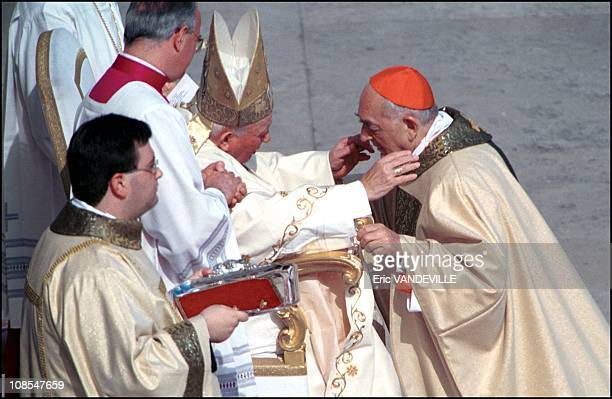 Consistory day John Paul II gives the cardinal ring to His Eminence Roberto Tucci in Rome Italia on February 23rd 2001