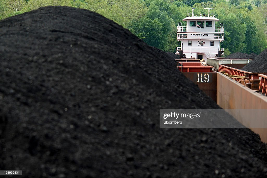Consol Energy's Champion Coal tow boat transport jumbo barges containing coal along the Monongahela River by outside Pittsburgh, Pennsylvania, U.S., on Wednesday, May 15, 2013. Coal's prospects are improving after its share of U.S. power generation fell last year to 34 percent, the lowest since at least 1973, Energy Department data show. Hotter temperatures this summer that prompt American households to use more air conditioning will boost demand for coal and the railroads that ship it. Photographer: Ty Wright/Bloomberg via Getty Images