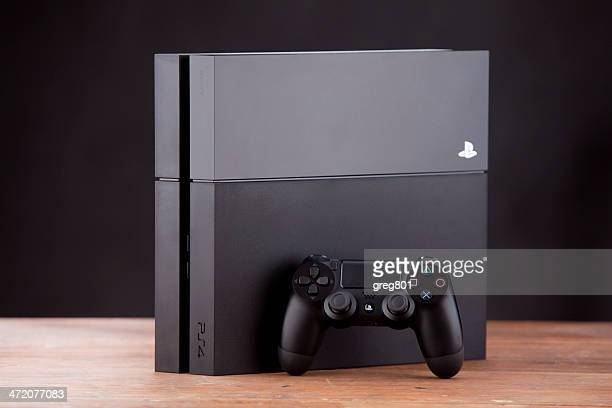 Console Playstation 4 and pad Dualshock on white background