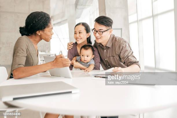 consolidating your debt - insurance agent stock pictures, royalty-free photos & images