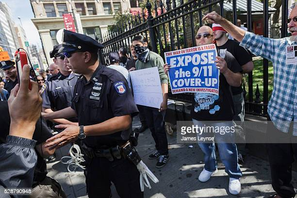 Conspiracists protest near ground zero on the 11th anniversary of the terrorist attacks on 9/11.