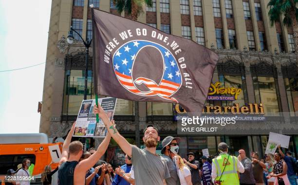 Conspiracy theorist QAnon demonstrators protest child trafficking on Hollywood Boulevard in Los Angeles California August 22 2020 A 2019 bulletin...