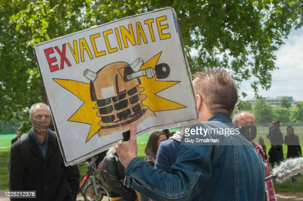 Conspiracy theorists gather at Hyde Park Corner to defy the emergency legislation and protest their claim that the Coronavirus pandemic is part of a...