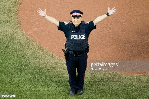 Const Ken Lam the man who apprehended and arrested Alek Minassian during the van attack is celebrated on Canada Day during the baseball game between...