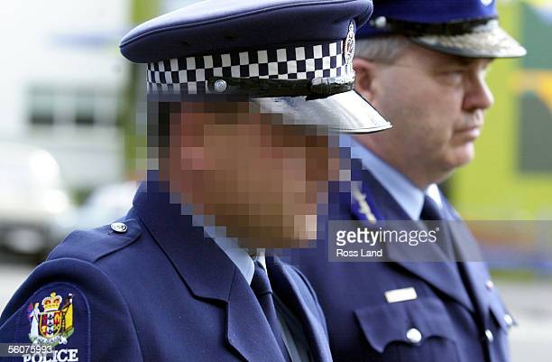Constable A leaves the Taranaki District Court with Assistant Police Comissioner Steve Long after appearing on a murder charge relating to the fatal...