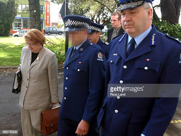 Constable A walks to the Taranaki District Court with his council Susan Hughs and Assistant Police Comissioner Steve Long to appear on a murder...