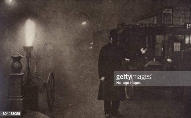 A constable directing traffic in the fog London c1910sc1920s Where Charing Cross meets Trafalgar Square