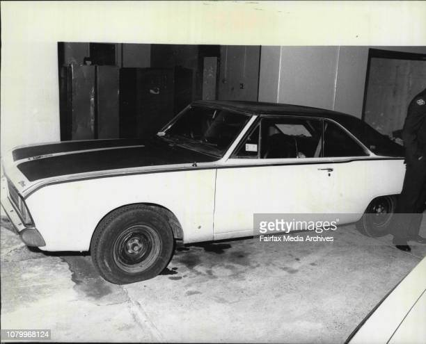 Constable Greg Coltman and Steve McGrath check the car in which they found escapes Noel Millard and Neil Connell sleeping at Balmain todayThe car was...