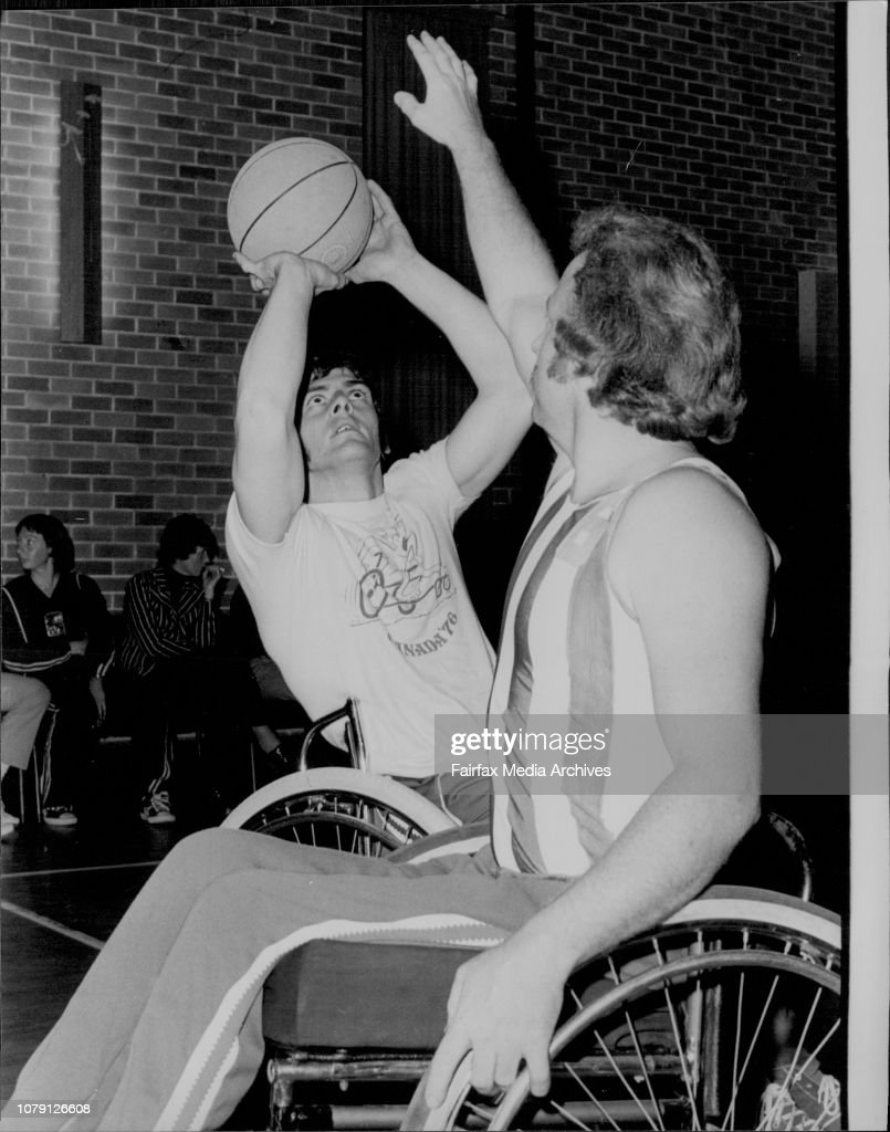 Constable John Kidd (left with ball) about to shoot during a game at Oakhill college.Other player right of pic is John Martin of Blaxland.Constable John Kidd of Baulkham hills, a paraplegic basketball player selected for the disabled Olympic is Toronto, p : News Photo