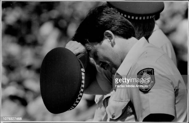 Constable Noel McMaster who is in the NSW Police Tactical Response Group wipes sweat away from his forehead whilst patroling the Hill at the SCG...