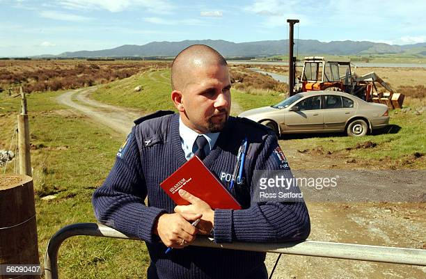 Constable Stu Martindale patrols the gate to the causeway at Lake Oneke South Wairarapa Friday where the murdered body of six year old Featherston...
