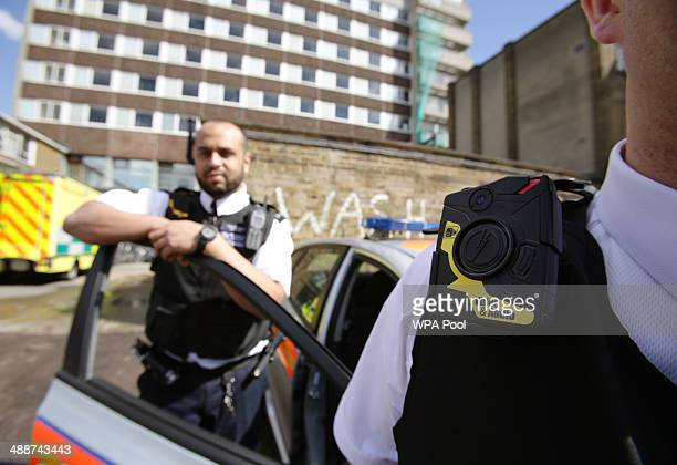 Constable Yasa Amerat and Constable Craig Pearson wearing their bodyworn video cameras ahead of a yearlong pilot scheme by the Metropolitan police at...