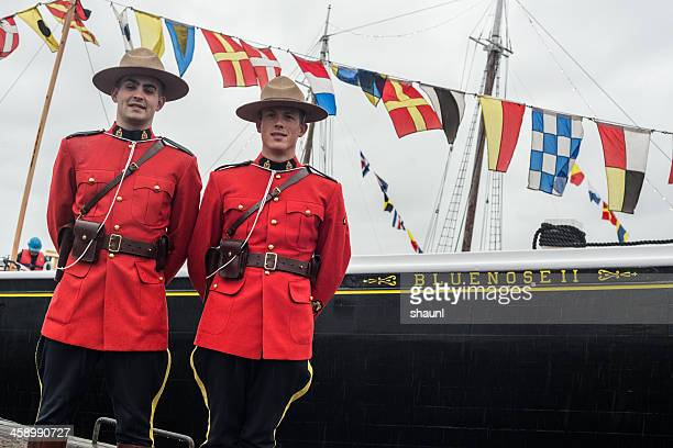 constables with bluenose ii - flag of nova scotia stock pictures, royalty-free photos & images