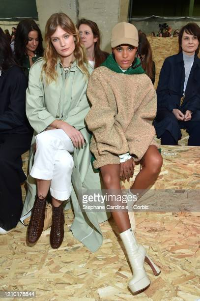 Constance Jablonski and Tina Kunakey attends the Lacoste show as part of the Paris Fashion Week Womenswear Fall/Winter 2020/2021 on March 03 2020 in...