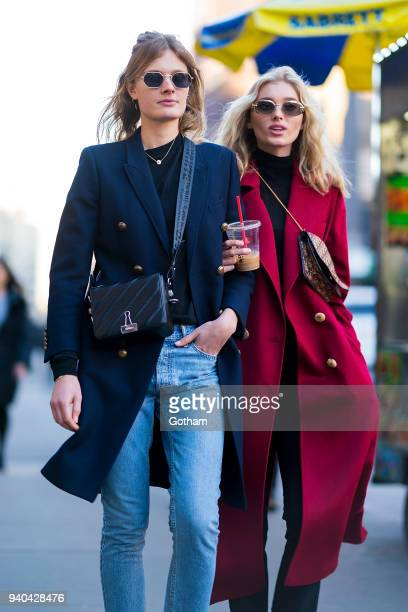 Constance Jablonski wearing an Yves Saint Laurent coat with Celine shoes and OffWhite handbage and Elsa Hosk wearing a Le Ru Basics coat are seen in...