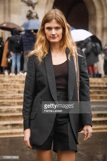 Constance Jablonski wearing Stella McCartney jacket, shorts, strap heels and bag outside Stella McCartney during Paris Fashion Week Womenswear...