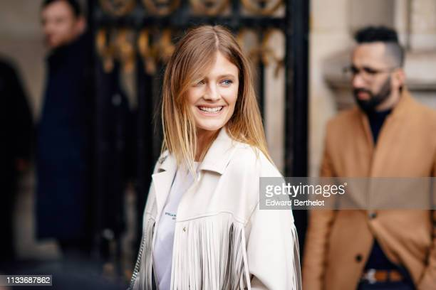 Constance Jablonski wears a fringed jacket outside Stella McCartney during Paris Fashion Week Womenswear Fall/Winter 2019/2020 on March 04 2019 in...