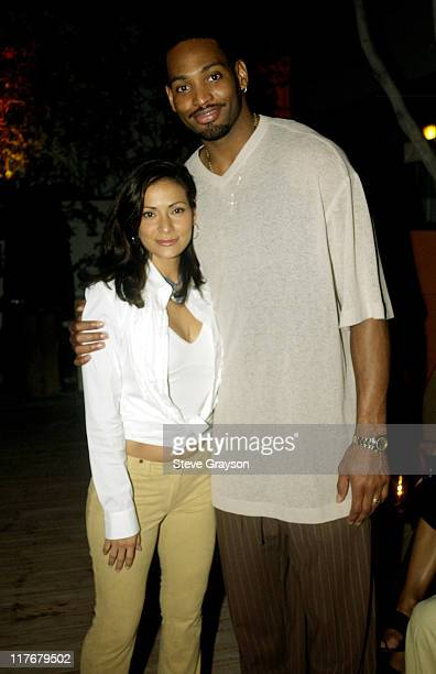 Constance Marie Robert Horry pose for photographers at the Los Angeles Lakers victory celebration at Ian Schrager's Ultra Chic Mondrian Hotel
