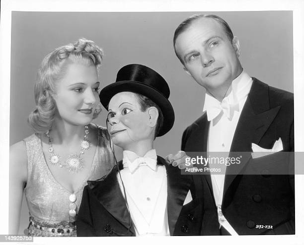 Constance Moore with her hand on Charlie McCarthy as Edgar Bergen looks to his left in publicity portrait for the film 'You Can't Cheat An Honest...