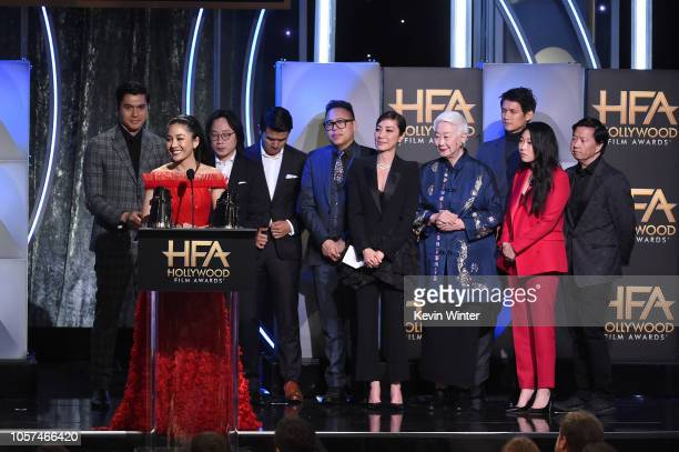 Constance Wu and Henry Golding, Jimmy O. Yang, Ronny Chieng, Nico Santos, Michelle Yeoh, Lisa Lu, Harry Shum Jr., Awkwafina, and Ken Jeong accept the...