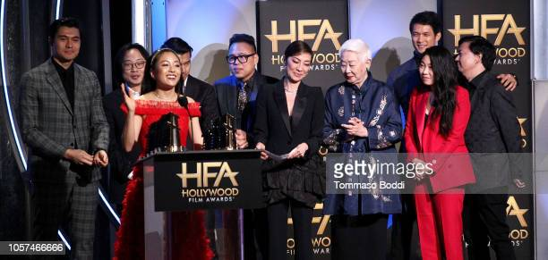 Constance Wu and Henry Golding Jimmy O Yang Ronny Chieng Nico Santos Michelle Yeoh Lisa Lu Awkwafina Harry Shum Jr and Ken Jeong accept the Hollywood...