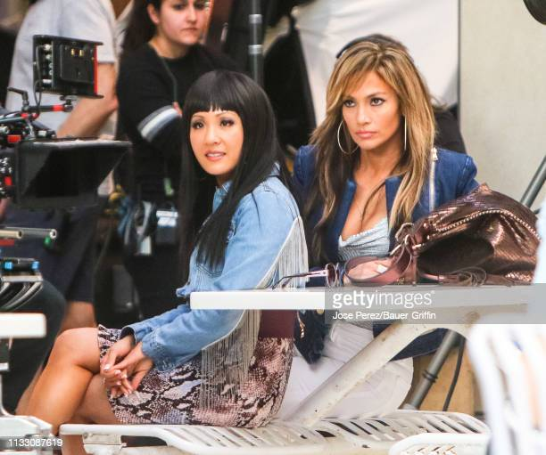 Constance Wu and Jennifer Lopez are seen on movie set of the 'Hustlers' on March 26 2019 in New York City
