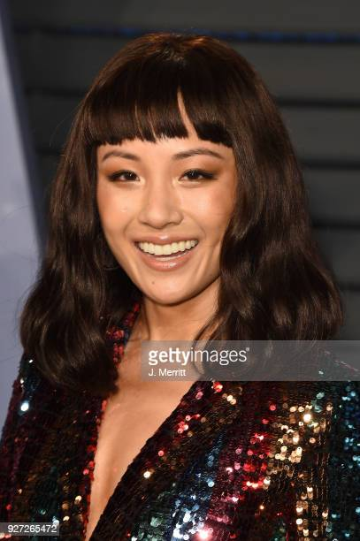 Constance Wu attends the 2018 Vanity Fair Oscar Party hosted by Radhika Jones at the Wallis Annenberg Center for the Performing Arts on March 4 2018...