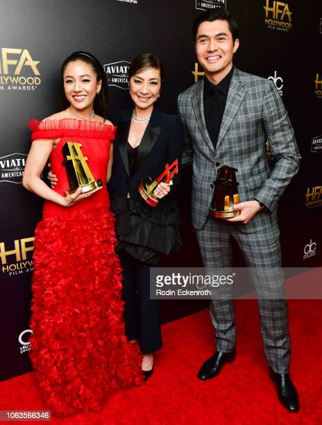 Constance Wu Michelle Yeoh and Henry Golding recipients of the Hollywood Breakout Ensemble Award for 'Crazy Rich Asians' pose in press room at the...