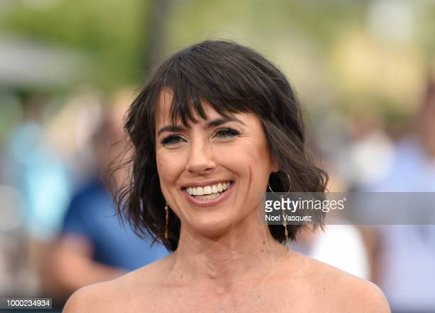 Constance Zimmer visits 'Extra' at Universal Studios Hollywood on July 16 2018 in Universal City California